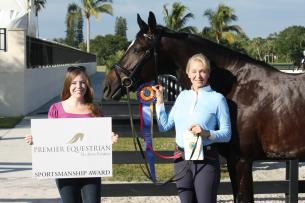 Dr. Heather Houck (right) and Elite are presented with the Premier Equestrian Sportsmanship Award by April Leonard