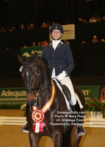 Debbie Hill is all smiles aboard Boccaaio IOF, Marchella Richardson 's 7-year-old Hanoverian gelding by Bugatti Hilltop out of Roxette by Rubinstein won Reserve Champion in both the Third Level and Fourth Level Championship