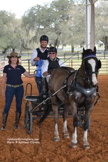 Co-Organizer Jennifer Matheson presents the winning ribbon to Cefnoakpark Bouncer and Wayne Humphreys with US Combined Driving Team veteran Joe Yoder as navigator Photo: © Kathleen O'Grady