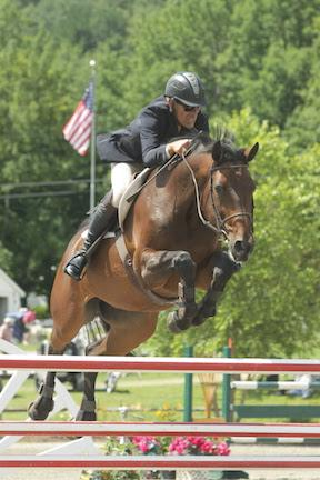 Ian Silitch and Cordovo on their way to victory in the 0,000 Vineyard Vines Welcome Stake, presented by Manchester Designer Outlets, on July 23 at the Vermont Summer Festival in East Dorset, VT. (Photo: David Mullinix Photography)