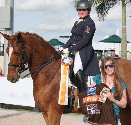 Tanya Strasser-Shostak (pictured on Deluxe Tyme) was awarded the GumBits Happy Horse Harmony Award at the 2015 Adequan Global Dressage Festival