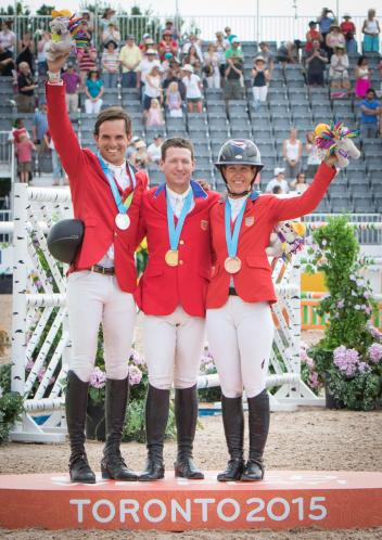 On the podium for the individual Jumping medal presentation at the Pan-American Games 2015 in Caledon Park, Toronto, Canada this evening: (L to R) silver medallist Andres Rodriguez (VEN), gold medallist McLain Ward (USA) and bronze medallist Lauren Hough (USA). (Photo: FEI/StockImageServices.com)
