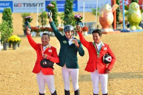 On the podium for the Individual Jumping Final at the Asian Games 2014 in Incheon (KOR) today: L to R - silver medallist Satoshi Hirao (JPN), gold medallist Abdullah Al Sharbatly (KSA) and bronze medallist Taizo Sugitani (JPN). (FEI/www.horsemovethailand.com)