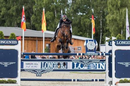 Ingrid Klimke (GER) is flawless to win her second CCI4* of the FEI Classics™ 2014/2015 with a confident clear Jumping round on FRH Escada JS at Luhmühlen (GER) presented by DHL. (Eventing Photo/FEI)