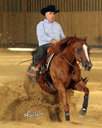 Jean Francois Ayoul riding his 10-year-old Quarter Horse gelding Slide On Sal (Photo: Andrea Bonaga)