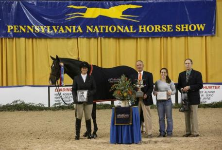 Jennifer Alfano and Candid captured the Pennsylvania National Horse Show Grand Hunter Championship. Photo by Emily Riden/Phelps Media Group.