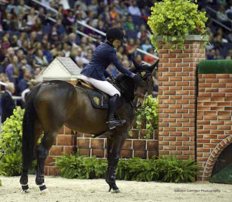 """Jessica Springsteen (USA) and Lisona  prepare for The Boeing Company 2014  International Jumper Puissance Class -the pair jumped 6'10"""" to win the class.  Photo copyright Alden Corrigan Photography."""