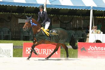 Julie Welles and Twan were victorious in the grand finale of the Vermont Summer Festival, the $50,000 Vermont Summer Celebration Grand Prix, held August 9 in East Dorset, VT. Photo by David Mullinix Photography