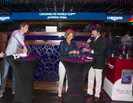 Conducting the draw for tomorrow's opening competition of the Longines FEI World Cup™ Jumping 2015 Final at the Hakkasan nightclub at the MGM hotel in Las Vegas: (L to R) defending champion Germany's Daniel Deusser, 2012 champion America's Beezie Madden and commentator Peter Doubleday. (FEI/Dirk Caremans)