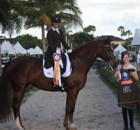 GumBits Awards the Happy Horse Harmony Award to winner Kasey Perry riding Trostruplunds Scarlet