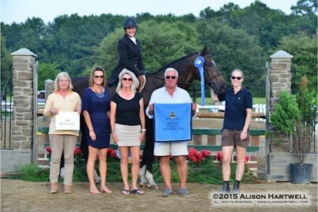 Kastel Denmark's Suzy Benson presents Julie Curtin with the Kastel Denmark Hunter Style of Riding Award along with Bob Bell, President of Classic Company and Awards Coordinator Robin McPherson. Photo: © Alison Hartwell 2015