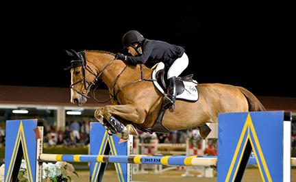 Katherine Dinan and Nougat Du Vallet, owned by Grand Road Partners, jump in the $50,000 Purina Animal Nutrition Grand Prix CSI2*-W Saturday night at HITS Thermal.(c) ESI Photography