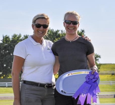 """Lisa Spillman (left) of TheraPlate presents the TheraPlate Peak Performance Award to Anna """"Lotta"""" Eklund (right) at the Kentucky Dressage Association 29th annual Dressage Show and Spring Warm-Up (Photo: Lisa Michelle Dean)"""