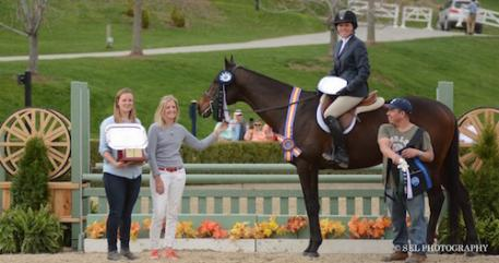Caitlin Malloy Brennan, owner Shelly Ferall, and groom with Keirstin Johnsen and Hennepin during their winner's presentation. Photo by Sarah Latterner