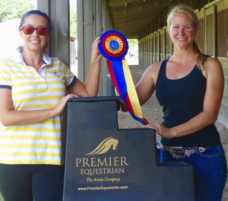 "Kiersten Main (right) awarded the title of ""Premier Equestrian,"" along with the Premier Equestrian mounting block, honored for her equestrian passion and sportsmanship"