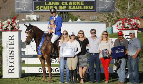 Lane Clarke with family, friends, his team, and representatives from the OC Register and Blenheim EquiSports. Photo by McCool Photography