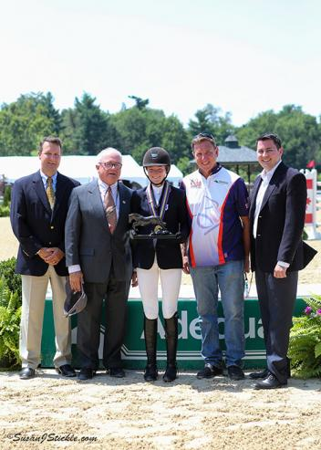 Lucy Deslauriers (center) receives the Jumping Style Award. (Photo: Susan J. Stickle Photography)