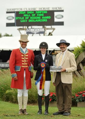 Lucy Deslauriers receives the Show Jumping Hall of Fame Style of Riding Award from Show Jumping Hall of Fame Executive Director Marty Bauman.