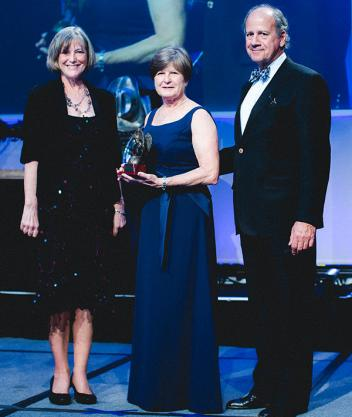 (L-R) Lynn Coakley, Margo Dewkett, 2013 Humanitarian Award Recipient, and John Long. Photo courtesy of Adam Brennan/USEF.