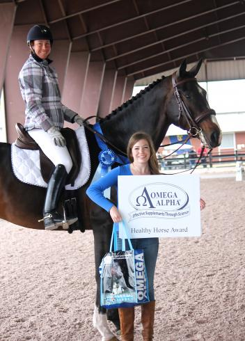 Don Romeo and his rider Jennifer Marchand win the Omega Alpha Healthy Horse Award at the Adequan Global Dressage Festival