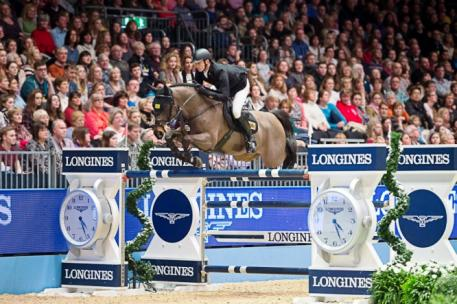 Germany's Marco Kutscher steered Cornet's Cristallo to victory at the seventh leg of the Longines FEI World Cup™ Jumping 2014/2015 Western European League at Olympia in London (GBR) today. (FEI/Jon Stroud)