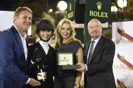 Stewart Wicht (right), President and CEO of Rolex Watch USA, presents a new Rolex watch to Georgina Bloomberg with Mark and Katherine Bellissimo of International Equestrian Group LLC.  Photo Credit Kit Houghton/Rolex