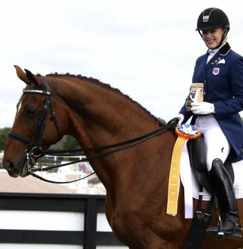 Mary-Cameron Rollins and Royal Prinz accept the GumBits Happy Horse Harmony Award at the 2015 Adequan Global Dressage Festival