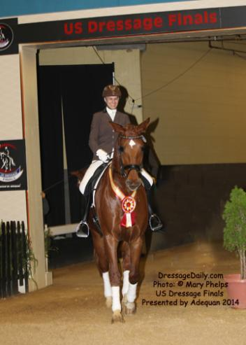 Amateur Reserve Second Level Champion Viki Meyers and Gold Rush enter the winners' circle in the Alltech Arena at the US Dressage Finals 2014