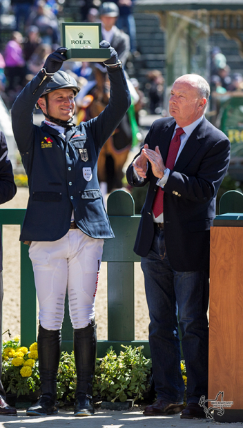 Winner Michael Jung hoists the winner's Rolex watch as Stewart Vicht, chief executive officer and president of Rolex Watch USA, applauds him. (Photo: Ben Radvanyi)
