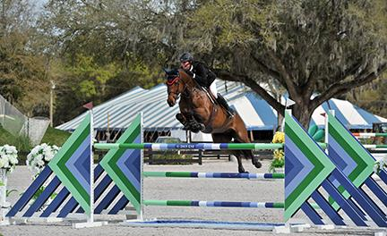 Michael Hughes and Luxina win the HITS Ocala $25,000 SmartPak Grand Prix on Thursday, March 12, 2015. (c) ESI Photography