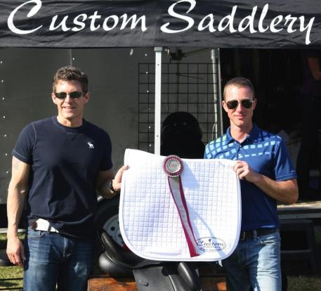 Cary Wallace (left) of Custom Saddlery presents Justin Hardin with the Custom MVR Award at the WEF Dressage Classic CDI-3*