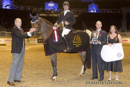 Neil Badcock, 44, of King City, Ont., won the Jump Canada Talent Squad Final on Saturday, November 8, at Toronto's Royal Horse Show riding Corrido. Peter Cullen, member of the Board of Directors of the Royal Agricultural Winter Fair Association, presented Badcock with the Championship trophy and ribbon. Photo Credit - Cealy Tetley
