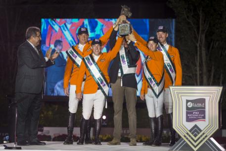 The Netherlands' team celebrate victory in the Furusiyya FEI Nations Cup™ Jumping 2014 Final in Barcelona, Spain tonight. (L to R), HRH Prince Faisal of Saudi Arabia and Dutch team members Jeroen Dubbeldam, Gerco Schroder, Chef d'Equipe Rob Ehrens, Maikel van der Vleuten and Jur Vrieling. (FEI/Dirk Caremans)