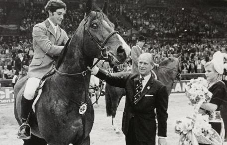 Prince Phillip Congratulates Norman Dello Joio & I Love You after they won the FEI World Cup Final in 1983.