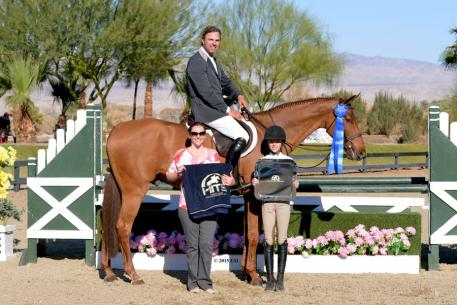 John Bragg and Laura Strasburg's Social hour take the blue for the third time Friday, February 6, in the 2015 HITS Desert Circuit in Thermal, California.(c) ESI Photography