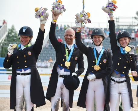 Kim Herslow, Steffen Peters, Sabine Schut-Kery, and Laura Gaves earn the team Dressage Gold at the Pan American Games, Toronto 2015 after a hard fought battle. Photo Photo: © Diana De Rosa