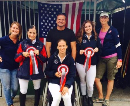 U.S Para- Dressage riders with their coaches at the Mulhouse, CPEDI3* Left to Right Rider Deborah Stanitski with ribbon and trainer Lauren Palmer Rebecca Hart (sitting) with Todd Flettrich; and Annie Peavy with Heather Blitz. (Photo: Rebecca Reno)