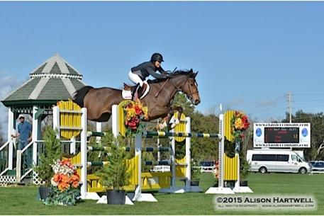 Penny Brennan and Japan fly over an oxer in today's $25,000 Foley RV Center Grand Prix, presented by EMO.