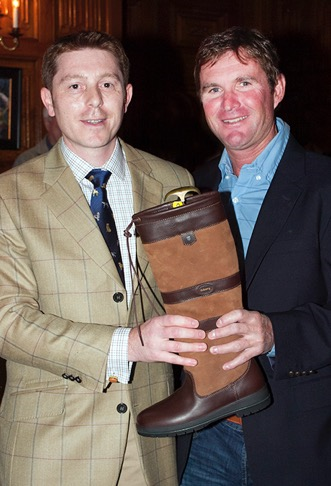 Phillip Dutton (right) receives his Dubarry boots from Danny Hulse. (Michelle Dunn photo)