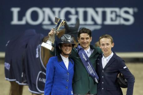On the podium at the Longines FEI World Cup™ Jumping 2015 Final in Las Vegas, USA today (L to R) runner-up Penelope Leprevost from France, winner Steve Guerdat from Switzerland and third-placed Bertram Allen from Ireland. (FEI/Dirk Caremans)
