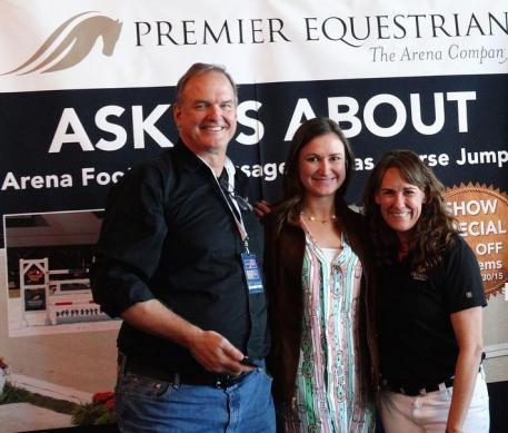 """Premier Equestrian"" Adreinne Lyle (center) with Mark Neihart (left), CEO of Premier Equestrian, and Heidi Zorn (right), President of Premier Equestrian, at Premier's booth at the 2015 Reem Acra FEI World Cup Dressage and Longines FEI World Cup Jumping Finals"