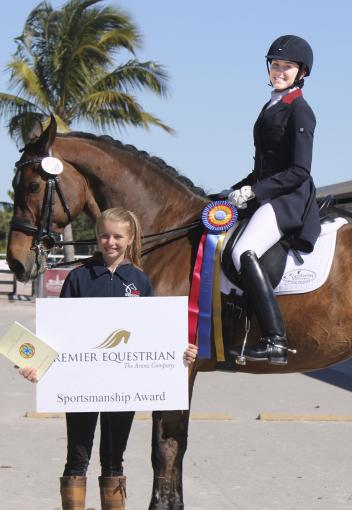Ayden Uhlir (riding Sjapoer) is presented with the Premier Equestrian Sportsmanship Award at the Adequan Global Dressage Festival