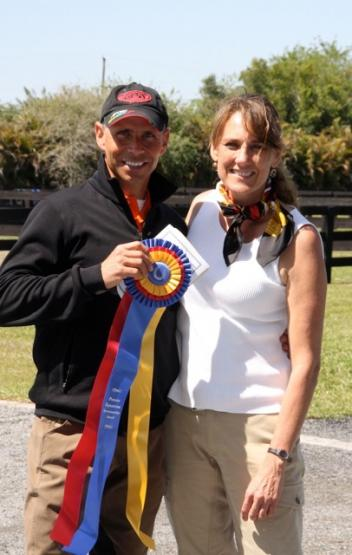 Heidi Zorn president of the Premier Sportsmanship award with Steffen Peters