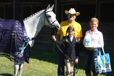 Omega Alpha Healthy Horse AM Power Leader and his team at The Arabian Celebration in Newberry, Florida. From left to right: Mike Miller of Al-Marah Arabian Horses, rider Rachel Ross, and Tara Ross