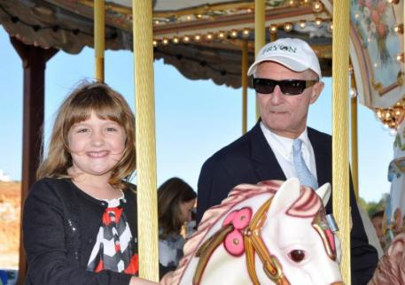 Rebecca Lawlor and George Morris take a spin on the new carousel.