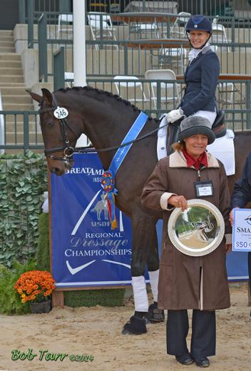 Debbie Hill & Boccaccio IOF accept congratulations from judge Hilda Gurney after winning the Fourth Level Open division at the Great American/USDF Region 2 Championship Show & KDA Fall Classic in Lexington, Kentucky.  Photo courtesy of Bob Tarr.