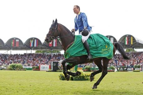 Christian Ahlmann competing in the Rolex Grand Prix Aachen 2014. Photo Credit: Rolex Grand Slam/Andreas Steindl