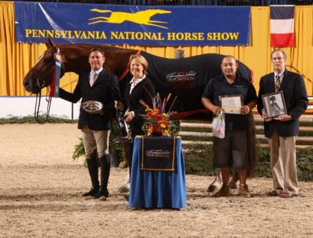 Grand Green Hunter Champion Golden Rule and Scott Stewart receive their award from Liz Shorb, President of the PA National Horse Show (c) Al Cook - alcookphoto.com