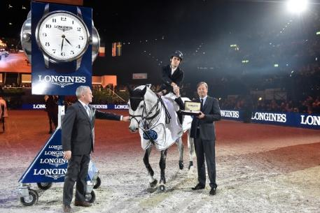 Spain's Sergio Alvarez Moya and Carlo pictured with (left) Chief Steward Matheus Locher and (right) Mr Charles Villoz, Longines' Vice-President and Head of International Sales, after winning today's tenth leg of the Longines FEI World Cup™ Jumping 2014/2015 Western European League at Zurich, Switzerland. (FEI/Karl-Heinz Freiler)