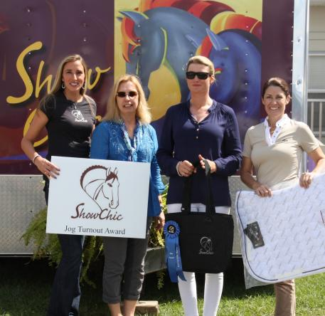 Silva Martin wins ShowChic's Jog Turnout Award at The Adequan Global Dressage Festival. From left to right; Krystalanne Shingler of ShowChic, Michele Hundt of ShowChic, Silva Martin and Kelly Molinari of Equiline.